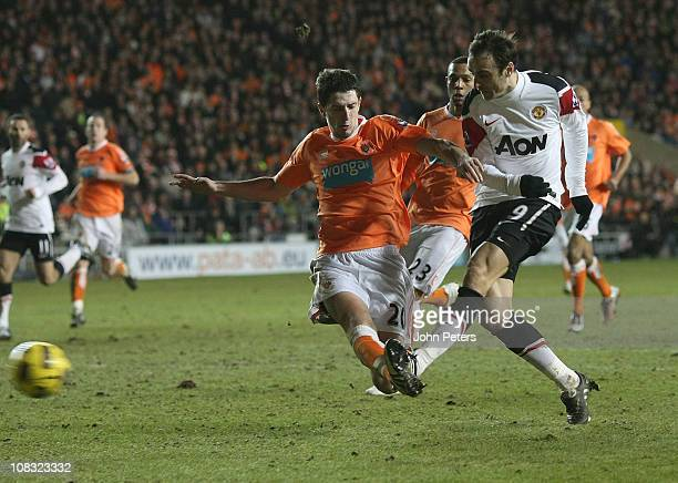 Dimitar Berbatov of Manchester United scores their third goal during the Barclays Premier League match between Blackpool and Manchester United at...