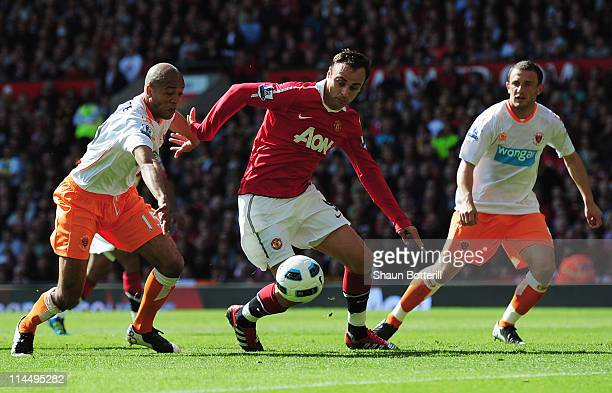 Dimitar Berbatov of Manchester United takes on Neal Eardley Alex JohnBaptiste of Blackpool during the Barclays Premier League match between...