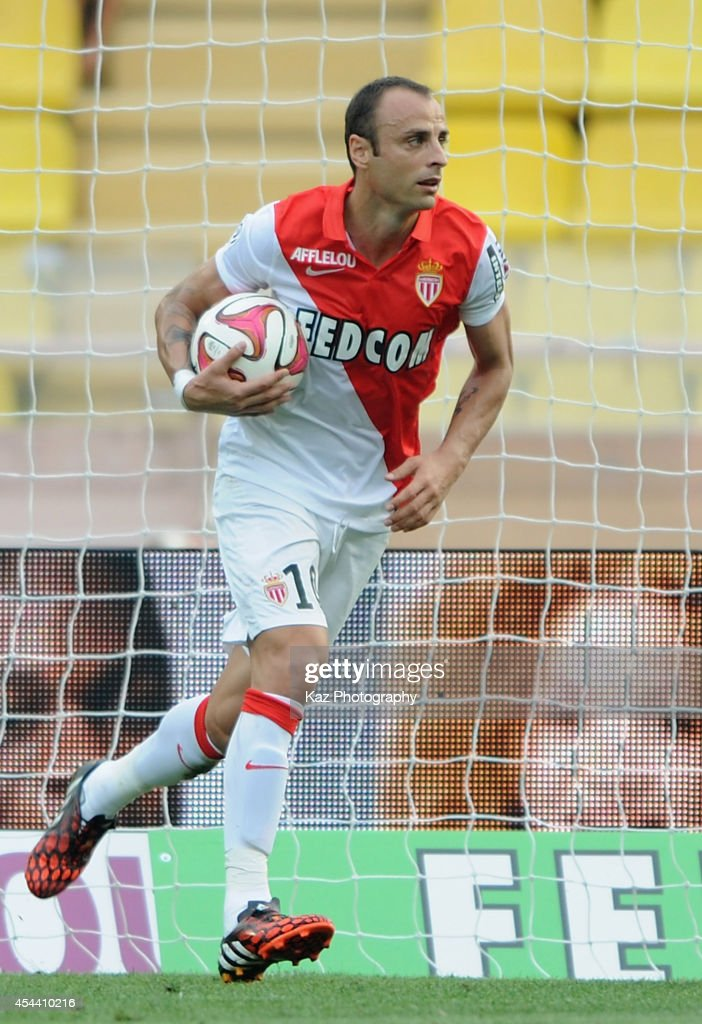 Dimitar Berbatov of Monaco celebrates scoring his team's first goal during the French Ligue 1 match between AS Monaco FC and LOSC Lille at Louis II Stadium on August 30, 2014 in Monaco, Monaco.