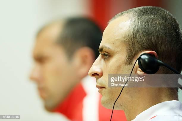 Dimitar Berbatov of Monaco speaks to the media as Leonardo Jardim the manager of Monaco looks on during the AS Monaco press conference ahead of the...
