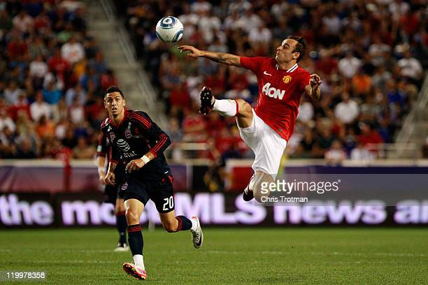 Dimitar Berbatov of the Manchester United controls the ball against Geoff Cameron of the MLS AllStars during the second half of the MLS AllStar Game...