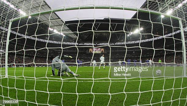 Dimitar Berbatov of Tottenham Hotspur beats Petr Cech of Chelsea to score their first goal from the penalty spot during the Carling Cup Final between...