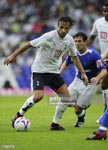 Dimitar Berbatov of Tottenham Hotspur takes the ball away from David Dunn of Birmingham City during the preseason friendly match between Birmingham...