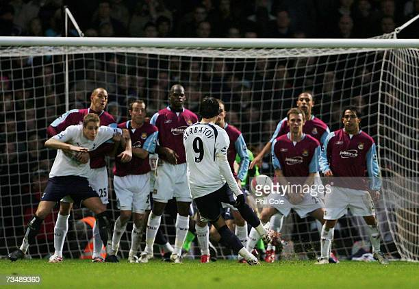 Dimitar Berbatov of Tottenham scores his team's third goal during the Barclays Premiership match between West Ham United and Tottenham Hotspur at...