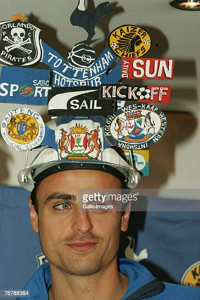 Dimitar Berbatov poses with a hat during the Orlando Pirates and Tottenham Hotspur Press Conference held at Vodaworld in Midrand ahead of their...