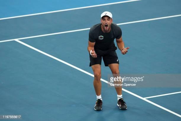 Dimitar Kuzmanov of Bulgaria celebrates winning match point during his Group C singles match against Alexander Cozbinov of Moldova during day three...