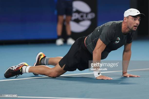 Dimitar Kuzmanov of Bulgaria celebrates winning match point during his Group C singles match against Steve Darcis of Belgium during day five of the...