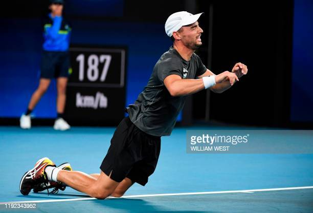 Dimitar Kuzmanov of Bulgariafalls falls to the ground after winning his men's singles match against Steve Darcis of Belgium at the ATP Cup tennis...