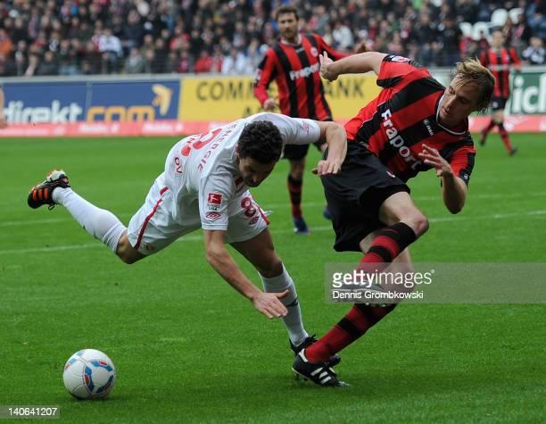 Dimitar Rangelov of Cottbus is challenged by Martin Amedick of Frankfurt during the Second Bundesliga match between Eintracht Frankfurt and Energie...