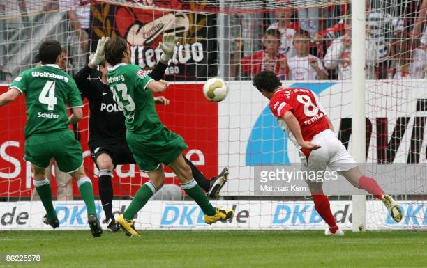 Dimitar Rangelov of Cottbus scores the first goal during the Bundesliga match between FC Energie Cottbus and VfL Wolfsburg at the Stadion der...