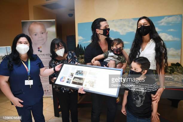 Dimitra Sarantakos , Criss Angel , his wife Shaunyl Benson with sons Johnny Crisstopher Sarantakos and Xristos Yanni Sarantakos attend the unveiling...