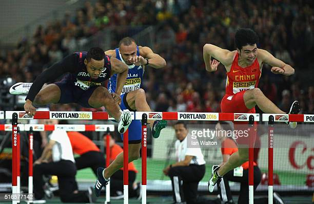 Dimitri Bascou of France and Wenjun Xie of China compete in the Men's 60 Metre Hurdles Heats during day three of the IAAF World Indoor Championships...
