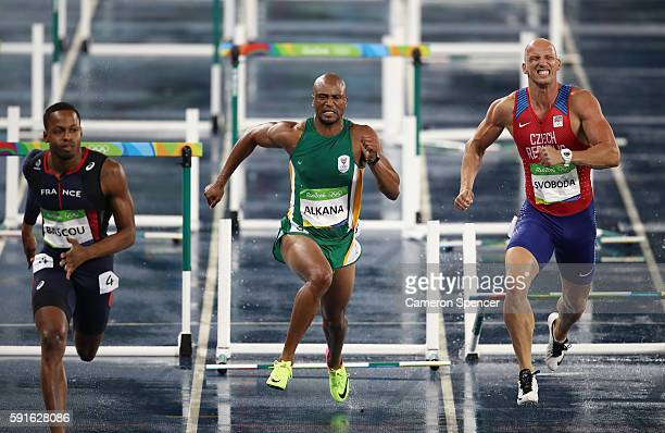 Dimitri Bascou of France Antonio Alkana of South Africa and Petr Svoboda of the Czech Republic compete during the Men's 110m Hurdles Round 1 on Day...