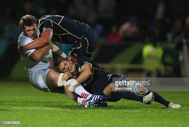 Dimitri Basilaia of Georgia is tackled during the IRB 2011 Rugby World Cup Pool B match between Scotland and Georgia at Rugby Park Stadium on...