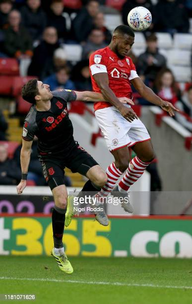 Dimitri Cavare of Barnsley in action with Stephen Ward of Stoke City during the Sky Bet Championship match between Barnsley and Stoke City at Oakwell...