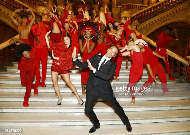 Dimitri Chamblas poses with dancers during the Longchamp 70th Anniversary Celebration at Opera Garnier on September 11 2018 in Paris France