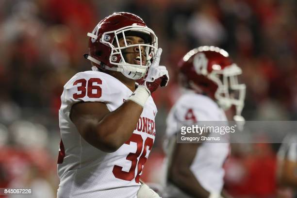 Dimitri Flowers of the Oklahoma Sooners celebrates after scoring a 36yard receiving touchdown during the third quarter against the Ohio State...