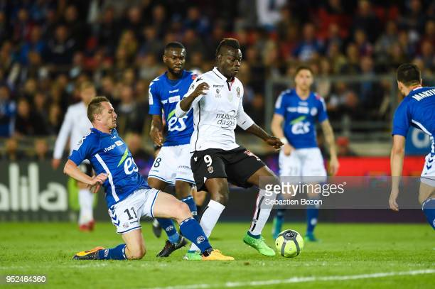 Dimitri Lienard of RC Strasbourg and Mario Balotelli of OGC Nice during the Ligue 1 match between Strasbourg and OGC Nice at on April 28 2018 in...