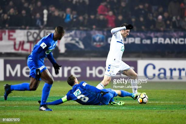 Dimitri Lienard of Strasbourg and Julien Deletraz of Grenoble during the French Cup match between Grenoble and Strasbourg at Stade des Alpes on...