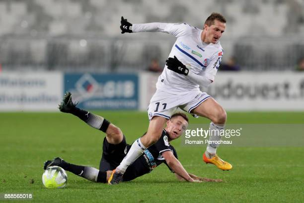 Dimitri Lienard of Strasbourg and Lukas Lerager of Bordeaux in action during the Ligue 1 match between FC Girondins de Bordeaux and Strasbourg at...