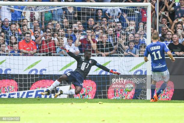 Dimitri Lienard of Strasbourg celebrates his goal against Ibrahim Amadou of Lille during the Ligue 1 match between Racing Club Strasbourg and Lille...