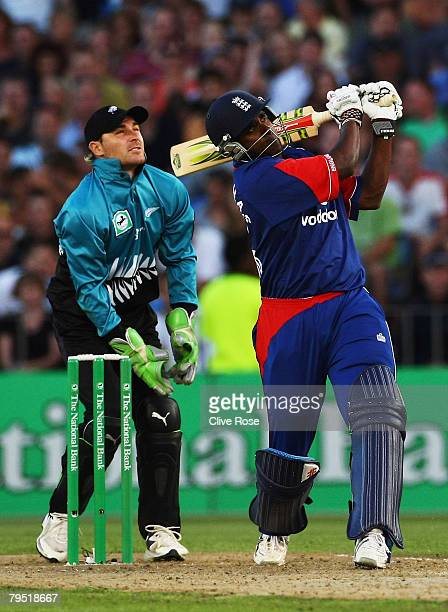 Dimitri Mascarenhas of England hits one of his four sixes during the Twenty20 International between New Zealand and England at Eden Park on February...