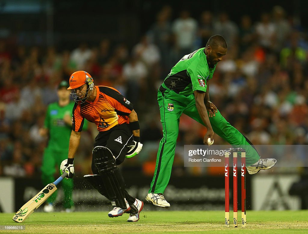 Dimitri Mascarenhas of the Stars attempts to run out Herschelle Gibbs of the Perth Scorchers during the Big Bash League semi-final match between the Perth Scorchers and the Melbourne Stars at the WACA on January 16, 2013 in Perth, Australia.