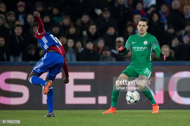 Dimitri Oberlin of Basel tries to score against goalkeeper Ederson of Manchester City during the UEFA Champions League Round of 16 First Leg match...