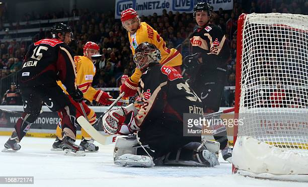 Dimitri Paetzold goaltender of Hannover makes a save on Carl Ridderwall of Duesseldorf during the DEL match between Hannover Scorpions and...