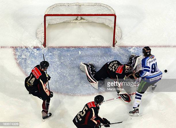 Dimitri Paetzold , goaltender of Hannover saves the shot of Rene Roethke of Straubing in front of the net during the DEL match between Hannover...