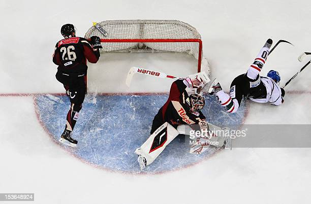 Dimitri Paetzold , goaltender of Hannover stops Patrick Seifert of Augsburg in front of the net during the DEL match between Hannover Scorpions and...