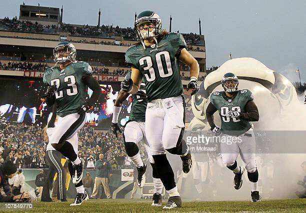 Dimitri Patterson Colt Anderson and Mike Patterson of the Philadelphia Eagles take the field to play against the Dallas Cowboys on January 2 2011 at...