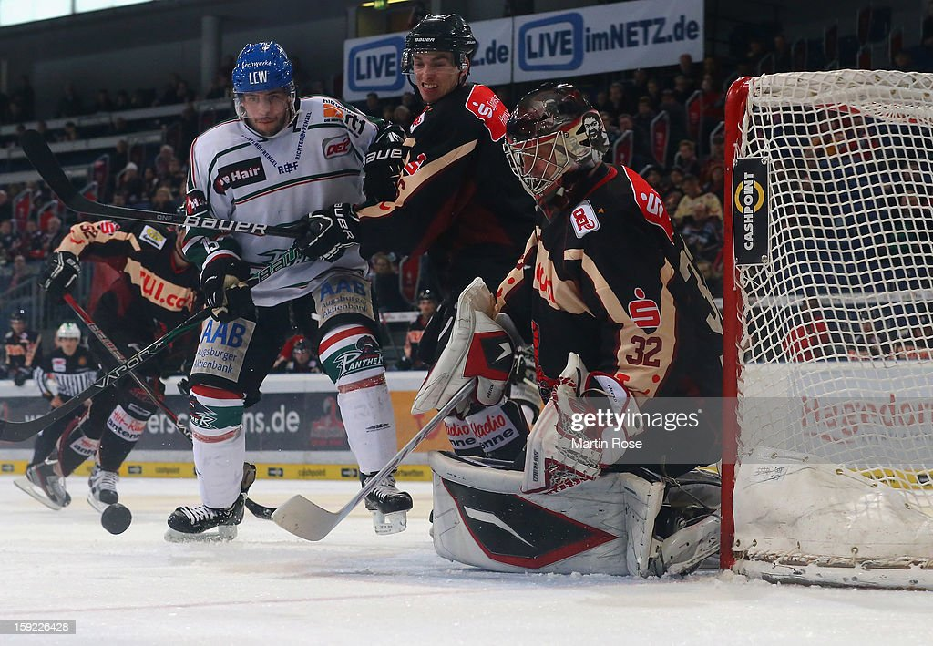 Dimitri Patzold, goaltender of Hannover makes a save during the DEL match between Hannover Scorpions and Augsburger Panther at TUI Arena at TUI Arena on January 9, 2013 in Hanover, Germany.