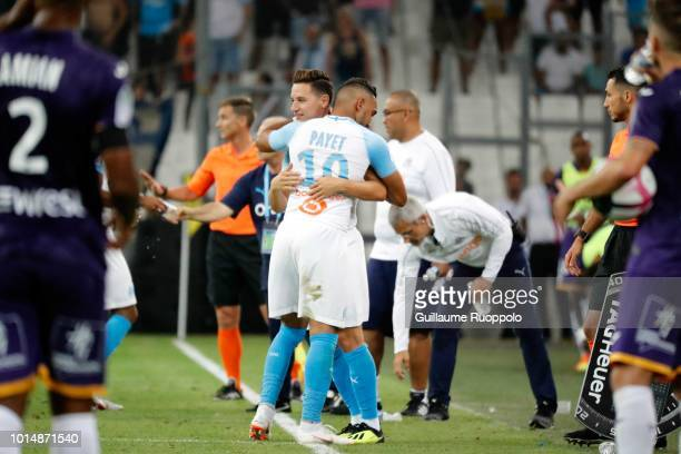 Dimitri Payet and Flaurian Thauvin of Marseille during the French Ligue 1 match between Marseille and Toulouse at Stade Velodrome on August 10 2018...