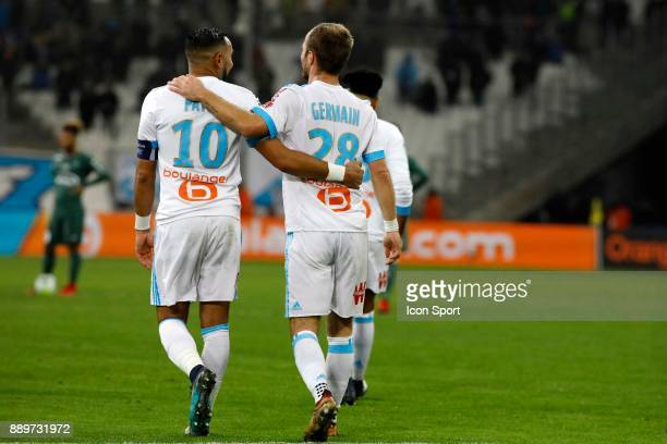 Dimitri Payet and Valere Germain of Marseille celebrate during the Ligue 1 match between Olympique Marseille and AS SaintEtienne at Stade Velodrome...