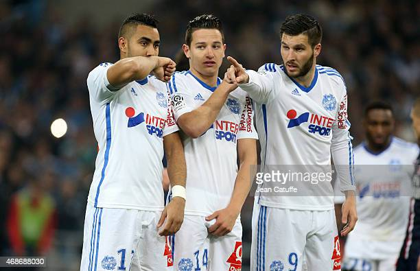 Dimitri Payet Florian Thauvin and AndrePierre Gignac of OM in action during the French Ligue 1 match between Olympique de Marseille and Paris...