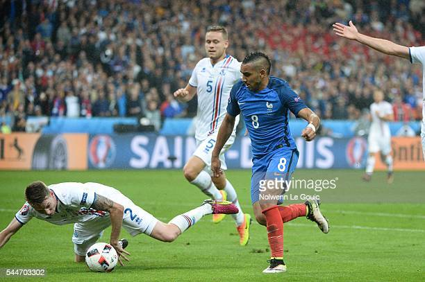 Dimitri Payet of France and Birkir Saevarsson during the UEFA Euro 2016 Quarter Final between France and Iceland at Stade de France on July 3 2016 in...