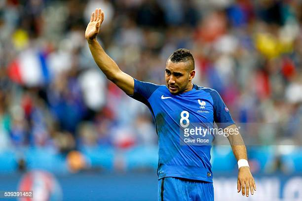 Dimitri Payet of France applauds supporters after his team's 2-1 win in the UEFA Euro 2016 Group A match between France and Romania at Stade de...