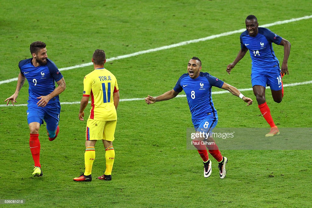 Dimitri Payet of France celebrates scoring his team's second goal during the UEFA Euro 2016 Group A match between France and Romania at Stade de France on June 10, 2016 in Paris, France.