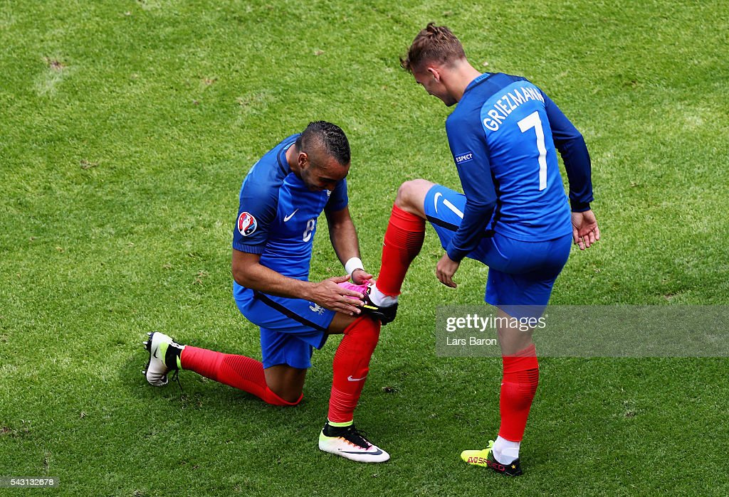 Dimitri Payet (L) of France congratulates his team mate Antoine Griezmann (R) on scoring their team's second goal during the UEFA EURO 2016 round of 16 match between France and Republic of Ireland at Stade des Lumieres on June 26, 2016 in Lyon, France.