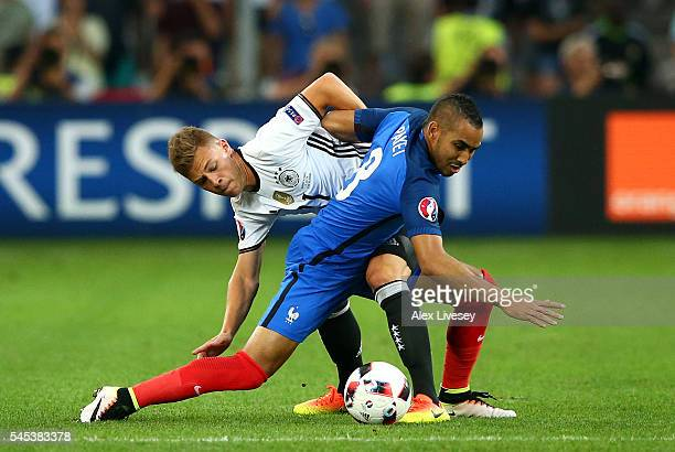 Dimitri Payet of France controls the ball under pressure of Joshua Kimmich of Germany during the UEFA EURO semi final match between Germany and...