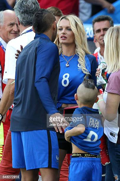 Dimitri Payet of France meets his wife Ludivine Payet and his younger son Noa Payet following the UEFA EURO 2016 round of 16 match between France and...