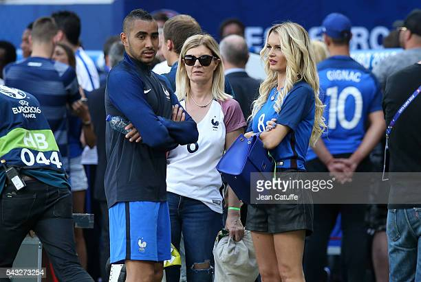 Dimitri Payet of France meets his wife Ludivine Payet following the UEFA EURO 2016 round of 16 match between France and Republic of Ireland at Stade...