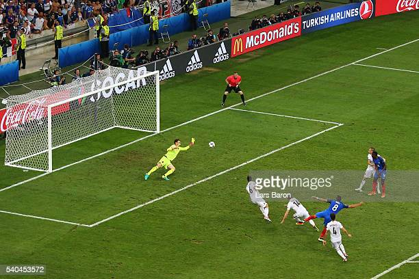 Dimitri Payet of France scores his sides second goal during the UEFA EURO 2016 Group A match between France and Albania at Stade Velodrome on June 15...