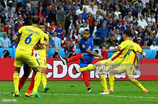 Dimitri Payet of France scores his team's second goal during the UEFA Euro 2016 Group A match between France and Romania at Stade de France on June...
