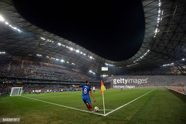 Dimitri Payet of France takes a corner kick during the UEFA EURO semi final match between Germany and France at Stade Velodrome on July 7 2016 in...