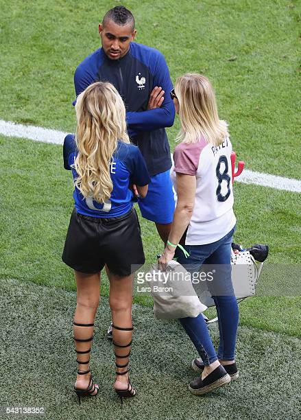 Dimitri Payet of France talks to his wife Ludivine after the UEFA EURO 2016 round of 16 match between France and Republic of Ireland at Stade des...