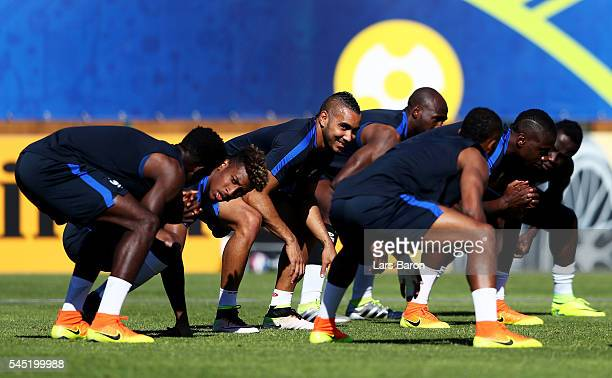 Dimitri Payet of France warms up during a France training session ahead of their UEFA Euro 2016 Semi final against Germany on July 6 2016 in...
