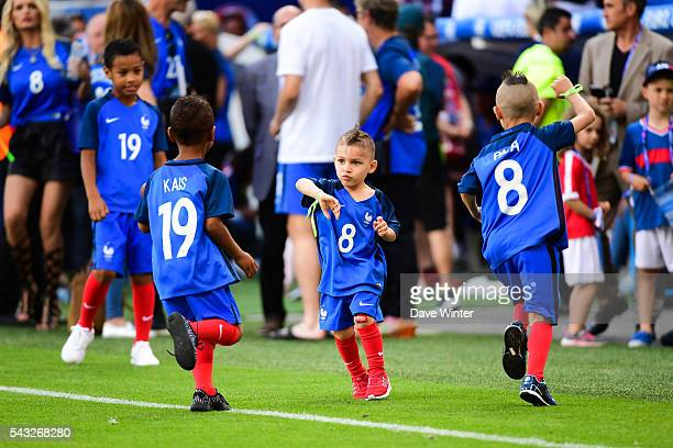 Dimitri Payet of France's children play with Bacary Sagna of France's children after the European Championship match Round of 16 between France and...