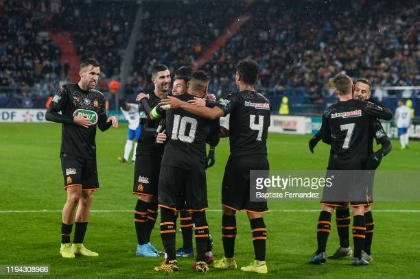 Dimitri PAYET of Marseille celebrates his goal with team mates during the French Cup Soccer match between US Granville and Olympique de Marseille at...